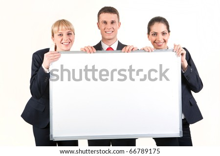 Portrait of confident business people holding whiteboard and looking at camera - stock photo