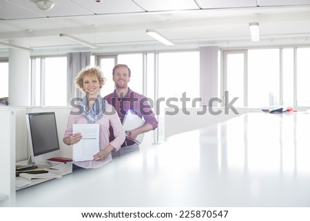 Portrait of confident business people standing in office - stock photo