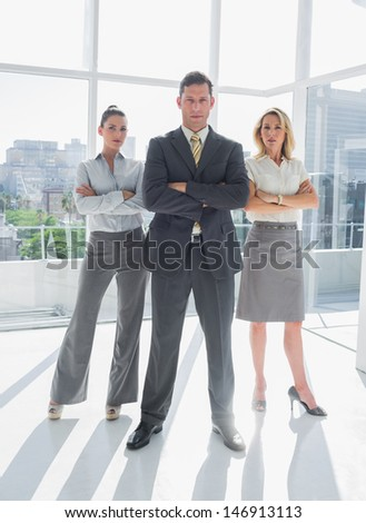 Portrait of confident business people standing together in their office - stock photo