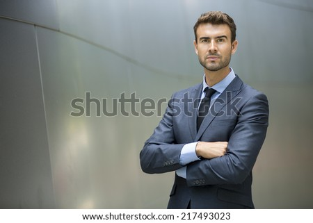 Portrait of confident businessman outside - stock photo