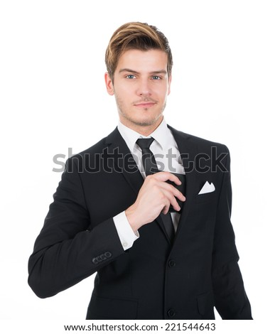 Portrait of confident businessman putting wallet in his pocket against white background - stock photo
