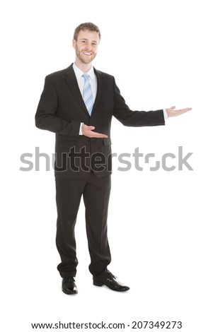 Portrait of confident businessman welcoming over white background - stock photo