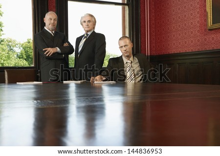 Portrait of confident businessmen at conference room - stock photo