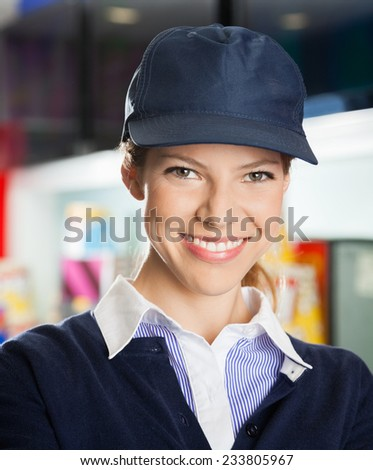 Portrait of confident female concession worker at cinema - stock photo