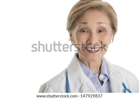 Portrait of confident female doctor smiling against white background - stock photo