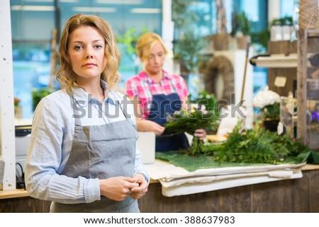 Portrait Of Confident Female Florist In Shop - stock photo