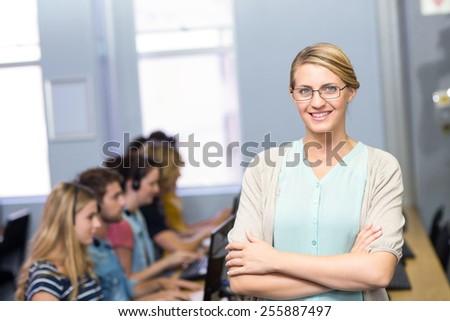 Portrait of confident female teacher in computer class - stock photo