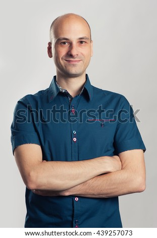 portrait of confident handsome bald man smiling - stock photo
