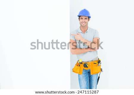 Portrait of confident male architect with bill board over white background - stock photo