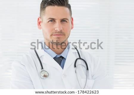 Portrait of confident male doctor - stock photo