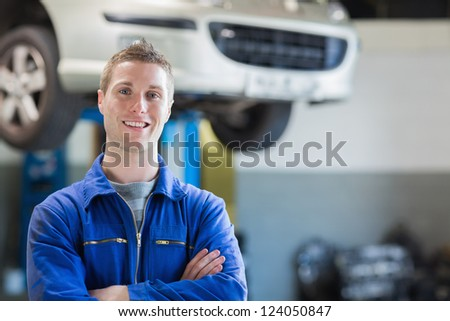 Portrait of confident male mechanic in workshop - stock photo