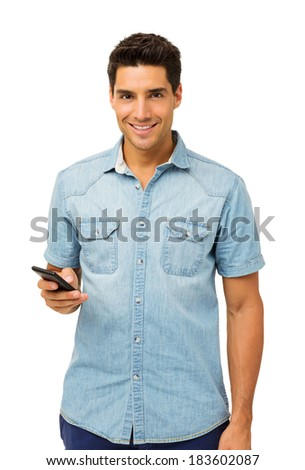 Portrait of confident man holding smart phone against white background. Vertical shot. - stock photo