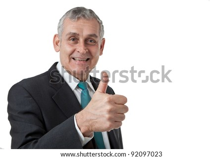 Portrait of confident mature businessman giving you thumbs up on white background - stock photo