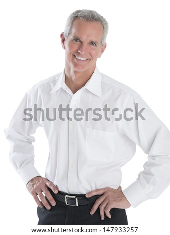 Portrait of confident mature businessman standing isolated over white background - stock photo