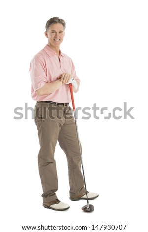 Portrait of confident mature man standing with golf club against white background - stock photo