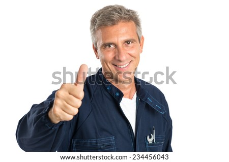 Portrait Of Confident Mature Mechanic Gesturing Thumbs Up Sign Isolated On White Backgriund - stock photo