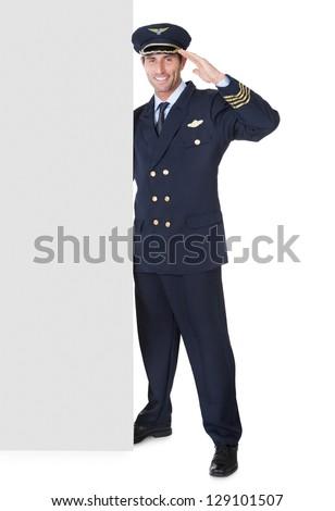 Portrait of confident pilot. Isolated on white - stock photo