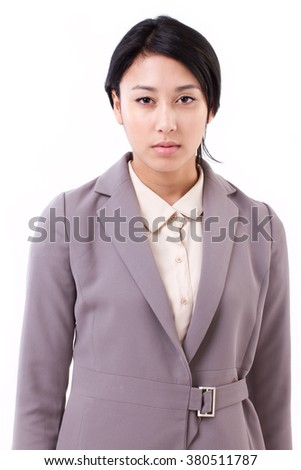 portrait of confident, serious asian caucasian business woman - stock photo