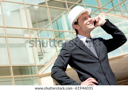 Portrait of confident smiling foreman calling by the phone - stock photo