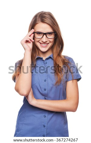 Portrait of confident successful business woman smiling holding her glasses at the rim - stock photo