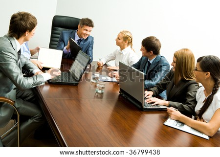 Portrait of confident team planning work and interacting with each other at briefing - stock photo