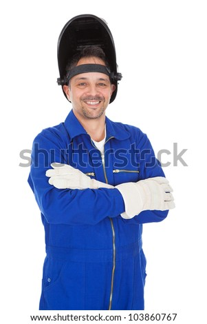Portrait of confident welder in the mask. Isolated on white - stock photo