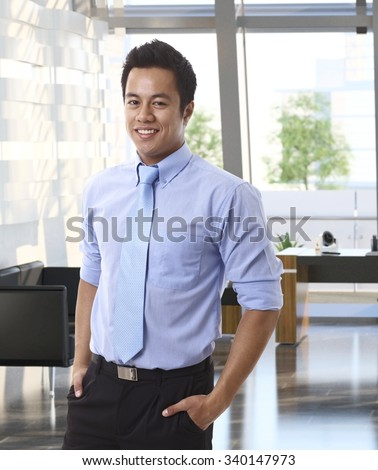 Portrait of confident young asian businessman at office. - stock photo