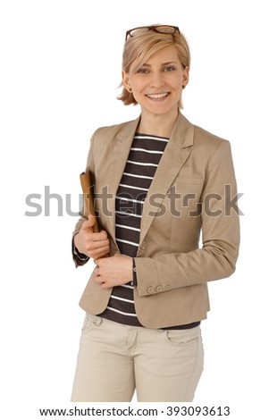 Portrait of confident young blonde businesswoman smiling, looking at camera. - stock photo