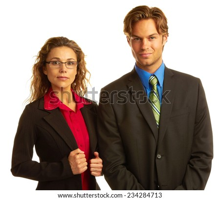 Portrait of confident young businessman and businesswoman standing together over white background - stock photo