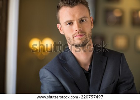 Portrait of confident young businessman at coffeeshop - stock photo
