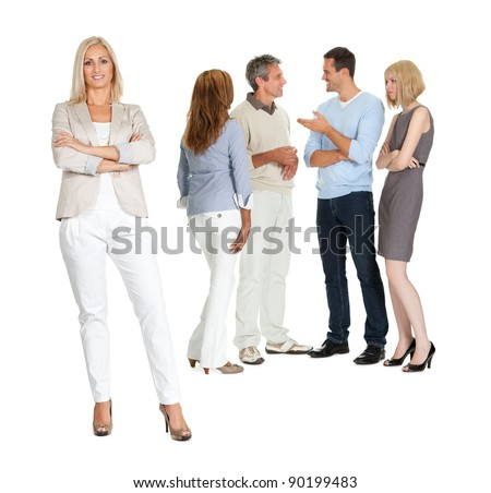 Portrait of confident young lady with group of people talking in background - stock photo