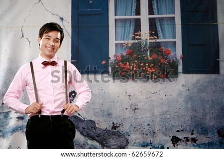 Portrait of confident young man smiling to you - stock photo
