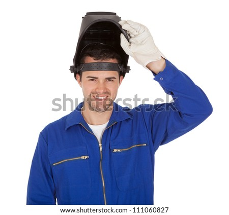 Portrait of confident young welder. Isolated on white - stock photo