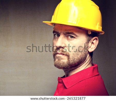 portrait of construction worker with protection - stock photo