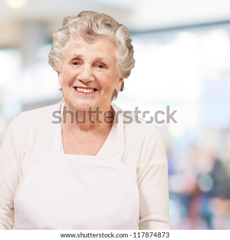 portrait of cook senior woman against a abstract background - stock photo