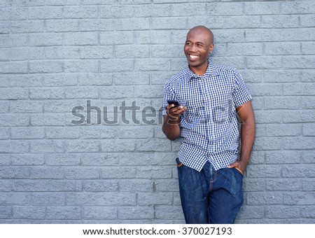 Portrait of cool african american man with a mobile phone - stock photo