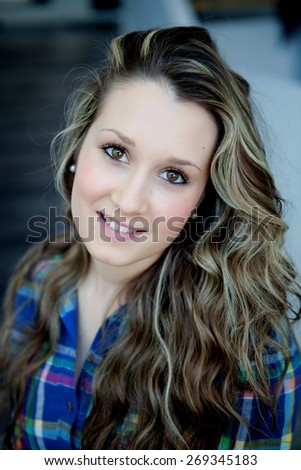 Portrait of cool blonde girl with brown eyes at home - stock photo