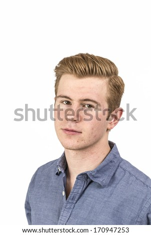 portrait of cool boy with red hair posing in studio - stock photo