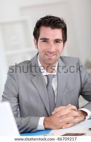Portrait of cool businessman - stock photo