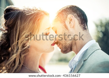 Portrait of couple of lovers kissing - stock photo