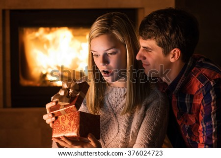 Portrait of couple with gift boxe - stock photo