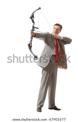 Portrait of courageous businessman holding crossbow and aiming at target - stock photo