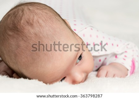 Portrait of crawling baby - stock photo
