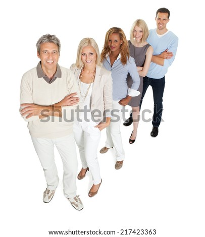 Portrait of creative business team standing in line on white background - stock photo