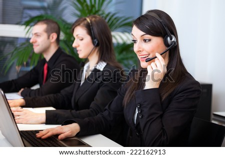 Portrait of customer representatives at work in their office - stock photo