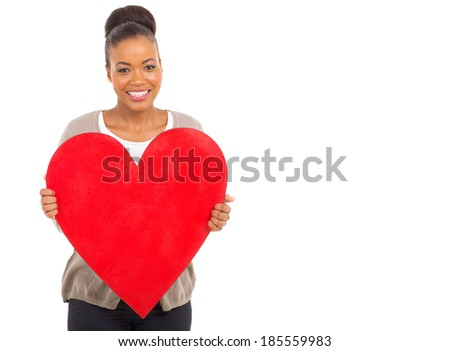 portrait of cute african girl showing red heart - stock photo