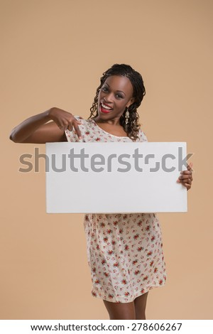 Portrait of cute african woman posing - holding blank copyspace sign - stock photo