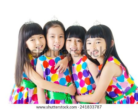 Portrait of cute asian girls in same dress - stock photo