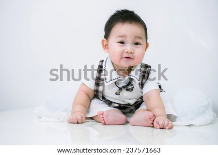 Portrait of cute baby, baby is a cute asian child - stock photo