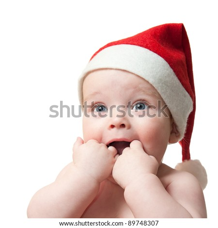 portrait of cute baby boy in christmas hat, isolated on white background - stock photo